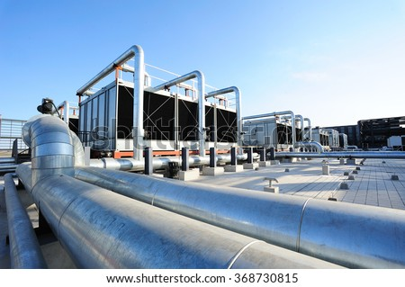 Sets of cooling towers in data center building. #368730815
