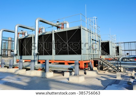 Sets of cooling towers in data center building. #385756063