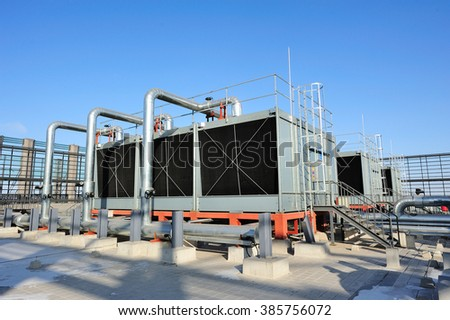 Sets of cooling towers in data center building. #385756072