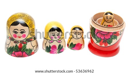 Sets of nesting dolls stand in row opened on white background