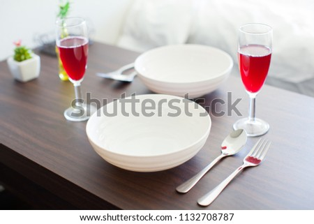 setting of tableware and cutlery #1132708787