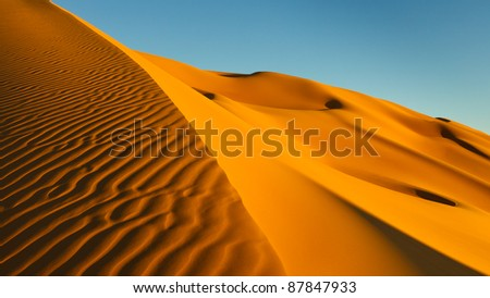 Setting sun creating amazing patterns in the sand. Sahara Desert, Libya.