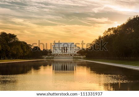 Setting sun illuminates Jefferson Memorial in Washington DC with reflections in new Reflecting Pool