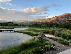 Setting sun over golf course with red rock cliffs in background - Durango, CO