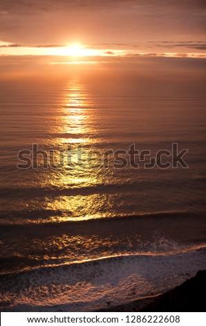 Setting sun reflected on sea. #1286222608