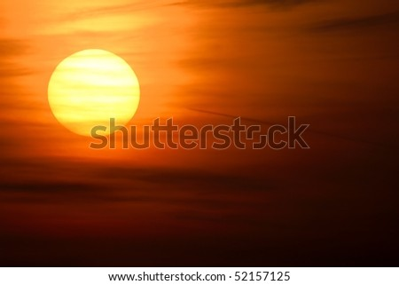 Stock Photo Setting sun with clouds in the sky