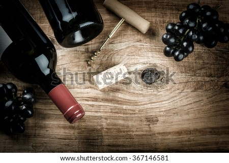 Shutterstock Setting with bottle of red wine, grape and corks. Wine list concept with copy space