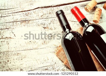 Shutterstock Setting with bottles of red wine and corks. Wine list concept with copy space
