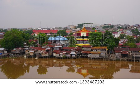 settlement - a residential area on the edge of the Siak river, the Siak river is the deepest river in Indonesia and becomes a trade route using ships. #1393467203