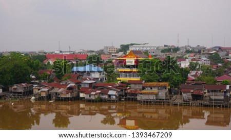 settlement - a residential area on the edge of the Siak river, the Siak river is the deepest river in Indonesia and becomes a trade route using ships. #1393467209