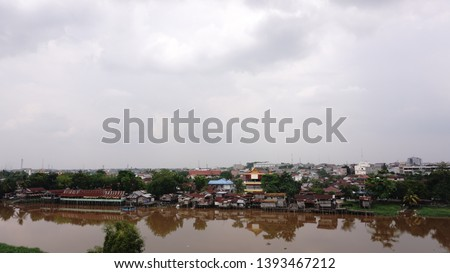 settlement - a residential area on the edge of the Siak river, the Siak river is the deepest river in Indonesia and becomes a trade route using ships. #1393467212