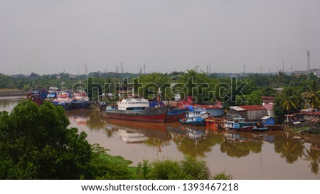 settlement - a residential area on the edge of the Siak river, the Siak river is the deepest river in Indonesia and becomes a trade route using ships. #1393467218
