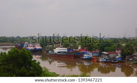 settlement - a residential area on the edge of the Siak river, the Siak river is the deepest river in Indonesia and becomes a trade route using ships. #1393467221