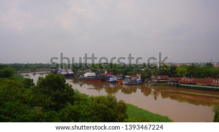 settlement - a residential area on the edge of the Siak river, the Siak river is the deepest river in Indonesia and becomes a trade route using ships. #1393467224