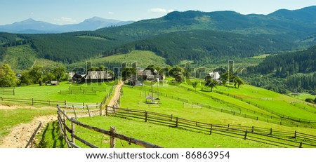 settlement in the mountains among the green pastures