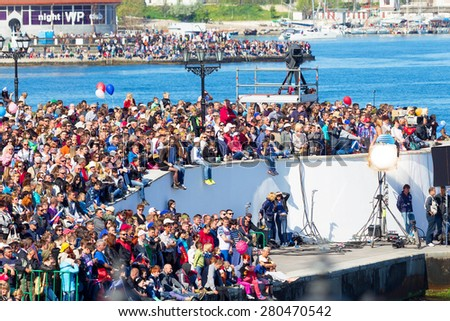 SEVASTOPOL, CRIMEA - MAY 9, 2015: A lot of people watching the parade in honor of the 70th anniversary of Victory Day on 9 May 2015, Sevastopol