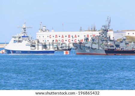 SEVASTOPOL, CRIMEA - MAY 7, 2014: Ships of Russian Navy Black Sea Fleet prepare for a Victory Day parade in Sevastopol