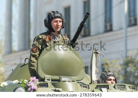 SEVASTOPOL, CRIMEA - MAY 9: The Victory Day parade of veterans and Russian military in honor of 70th anniversary on May 9, 2015 in downtown Sevastopol, Crimea. Crew of BTR-80 is greeted by the crowd.