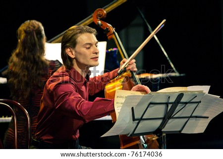 SEVASTOPOL, UKRAINE - APRIL 19: Alina Kabanova (piano) and Fedor Elesin (cello) from the group Beethoven Duo perform at the festival South Window on April 19, 2011 in Sevastopol, Ukraine.