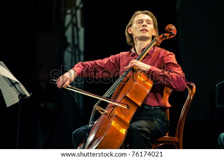 SEVASTOPOL, UKRAINE - APRIL 19: Fedor Elesin on cello from the group Beethoven Duo performs at the festival South Window on April 19, 2011 in Sevastopol, Ukraine.