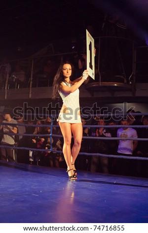 SEVASTOPOL, UKRAINE - 03 APRIL:  girl announces first round at Ukrainian championship MIX FIGHT, April 03, 2011 in Sevastopol, Ukraine.