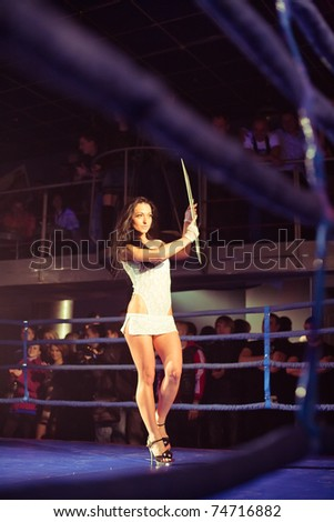 SEVASTOPOL, UKRAINE - 03 APRIL:  girl announces first round at Ukrainian championship MIX FIGHT, April 03, 2011 in Sevastopol, Ukraine.