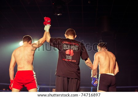 SEVASTOPOL, UKRAINE - 03 APRIL: Winner Maslennikov at Ukrainian championship MIX FIGHT, April 03, 2011 in Sevastopol, Ukraine.