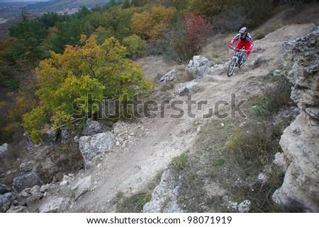 "SEVASTOPOL, UKRAINE - NOVEMBER 2: Unknown racer on the training session of the mountain bike event ""Listopad Bike Session 2011"" on November 2, 2011 in Sevastopol, Ukraine"