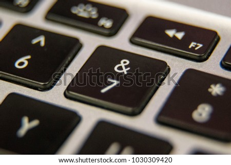 Seven 7 ampersand and Keyboard key button press type close up macro desktop laptop computer black silver detail technology blog write letter alphabet
