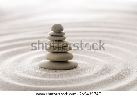 Seven balancing stones. Japanese zen garden meditation for concentration and relaxation sand for harmony and balance in pure simplicity - macro lens shot.