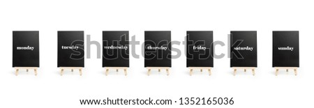 Seven blackboards with the days of the week #1352165036