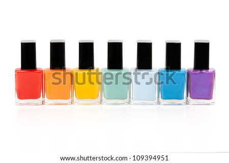 seven bottles of nail varnish on a white background
