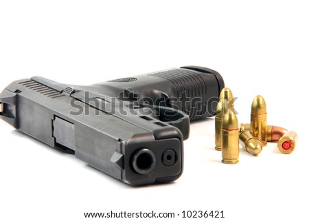 seven bullets and handgun closeup isolated on white background focus on bullets