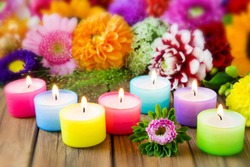 Seven colorful candles and bouquet of flowers