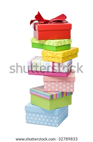 seven colorful gift boxes stacked irregularly, isolated on white - stock photo