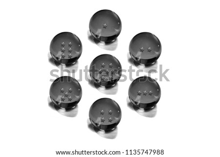Stock Photo Seven crystal ball black with white background.Dragonball Z or Dragonball GT and Dragonball Super.