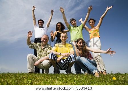 seven friends on the grass