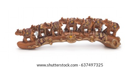 Seven Indian elephants made of sandalwood on a white background