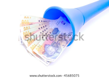 Seven one hundred South African Rands notes in a blue Vuvuzela soccer fan horn. Image isolated on white studio background.