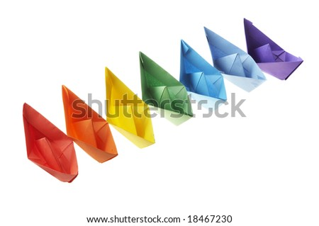 Seven paper ships of different color