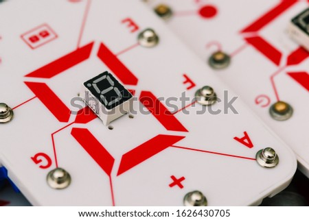 Seven-segment indicator. Display device for digital information. Studying physics and electrical engineering at school. Digital LED indicators, robotics and radio components.