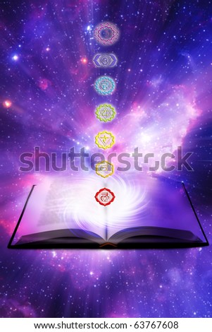 seven symbols of chakra with a book over a starry Universe like a concept for lesson of reiky, chakra and yoga