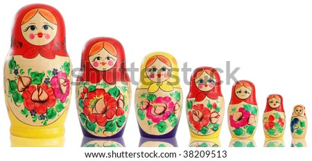 Seven traditional wooden Russian dolls. Isolated on white background. - stock photo