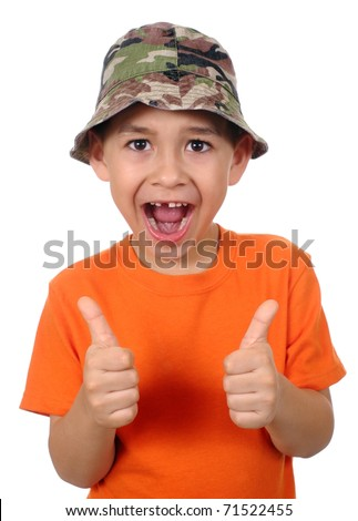 seven year old boy missing tooth giving thumbs up sign, isolated on pure white background