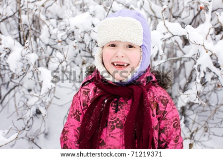 Seven years girl smiling cold sunny day outdoors