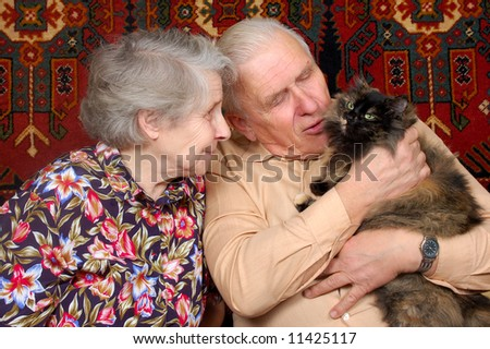 seventy year old couple with cat