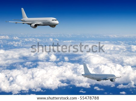 Several aircraft in blue sky