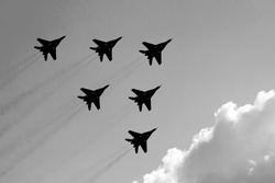 several aircraft in the sky.black and white