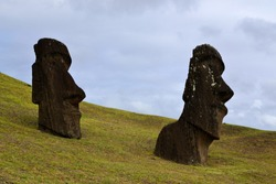 Several ancient Moai rest at their quarry in Rano Raraku, Easter Island. Work on these great sculptures stopped mysteriously suddenly, as carvings are found in every stage of the production process.