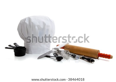 several baking utensils with a chef's hat on white background - stock photo